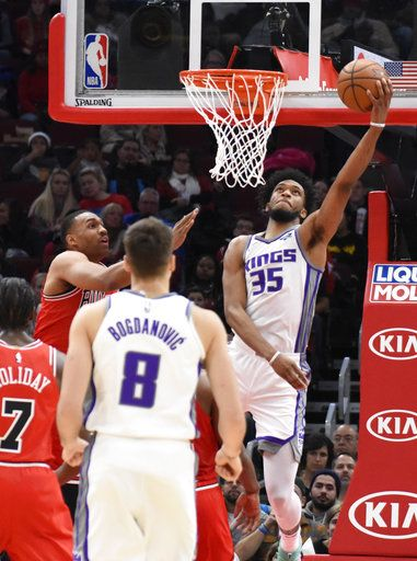 Sacramento Kings forward Marvin Bagley III (35) goes to the basket as Chicago Bulls forward Jabari Parker, left, defends him during the second half of an NBA basketball game Monday, Dec. 10, 2018, in Chicago. The Kings won 108-89.