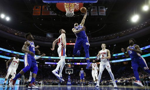 Philadelphia 76ers' Ben Simmons (25) goes up for a dunk against Detroit Pistons' Jon Leuer (30) during the first half of an NBA basketball game, Monday, Dec. 10, 2018, in Philadelphia.