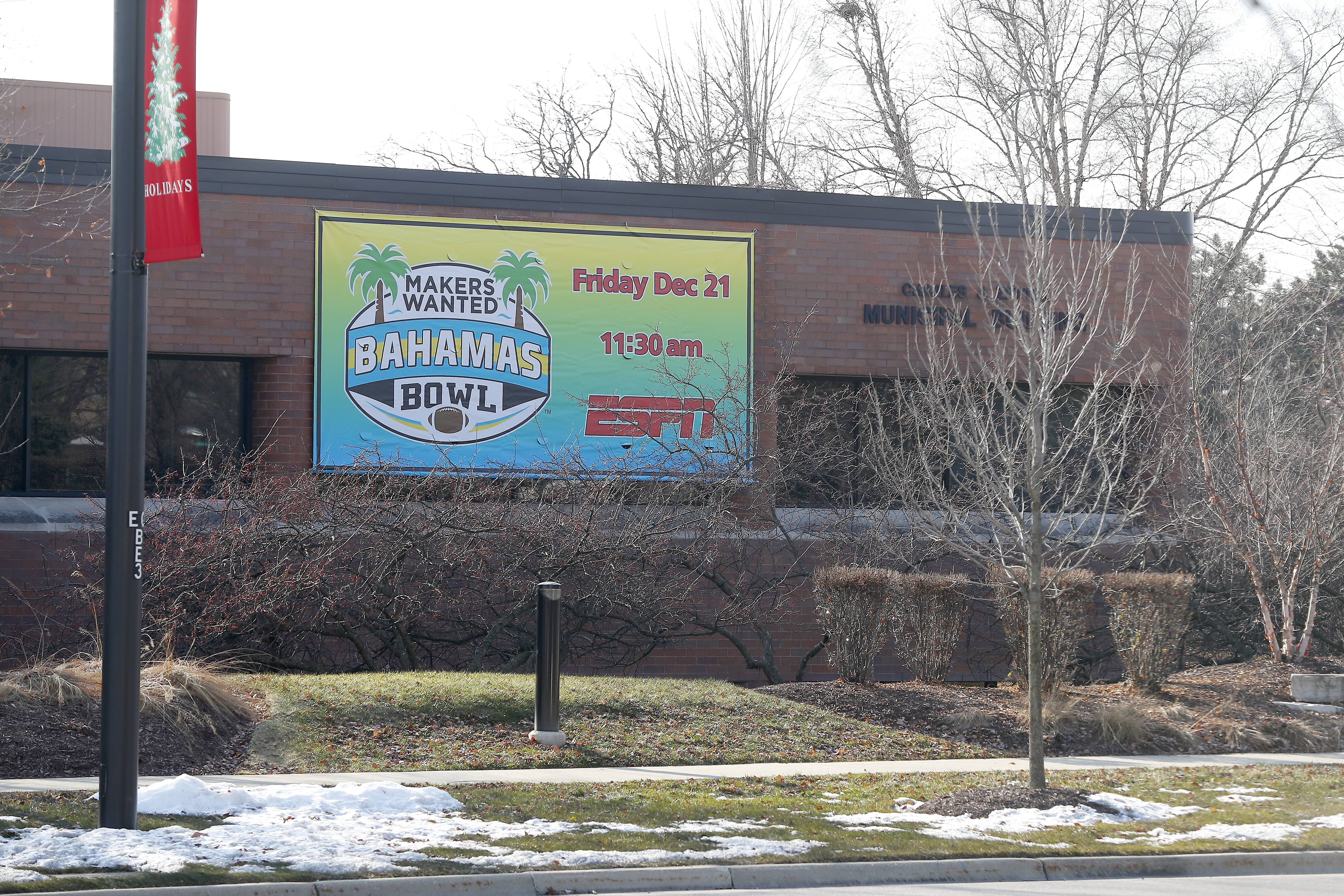 The banner on the side of Elk Grove Village's village hall promotes the bowl game the village is spending $300,000 to sponsor.