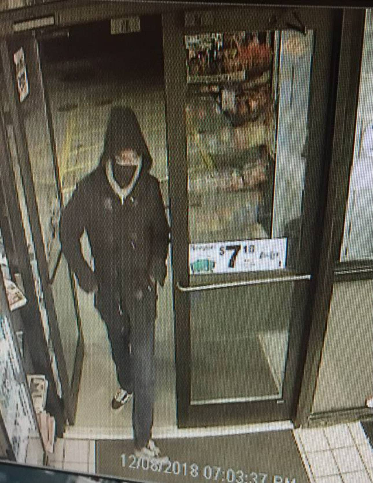 Downers Grove police say a male robber wearing a mask showed a gun and demanded cash at the Bucky's Express at 2181 63rd St. The thief entered the store Dec. 8 just before closing, police said.
