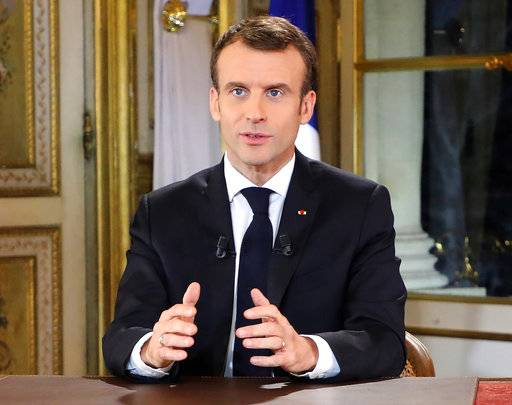 French President Emmanuel Macron poses before a special address to the nation, his first public comments after four weeks of nationwide 'yellow vest' protests, at the Elysee Palace, in Paris, Monday, Dec. 10, 2018. Facing exceptional protests, French President Emmanuel Macron is promising to speed up tax relief for struggling workers and to scrap a tax hike for retirees. (Ludovic Marin/Pool Photo via AP)