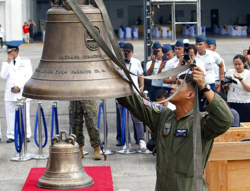 Philippine Air Force personnel unload three church bells seized by American troops as war trophies more than a century ago, as they arrive Tuesday, Dec. 11, 2018 in suburban Pasay city� southeast of Manila, Philippines. American occupation troops took the bells in 1901 from a Catholic church following an attack by machete-wielding Filipino villagers, who killed 48 U.S. troops in the town of Balangiga on central Samar island in one of the U.S. Army's worst single-battle losses of that era. The bells are revered by Filipinos as symbols of national pride. (AP Photo/Bullit Marquez)