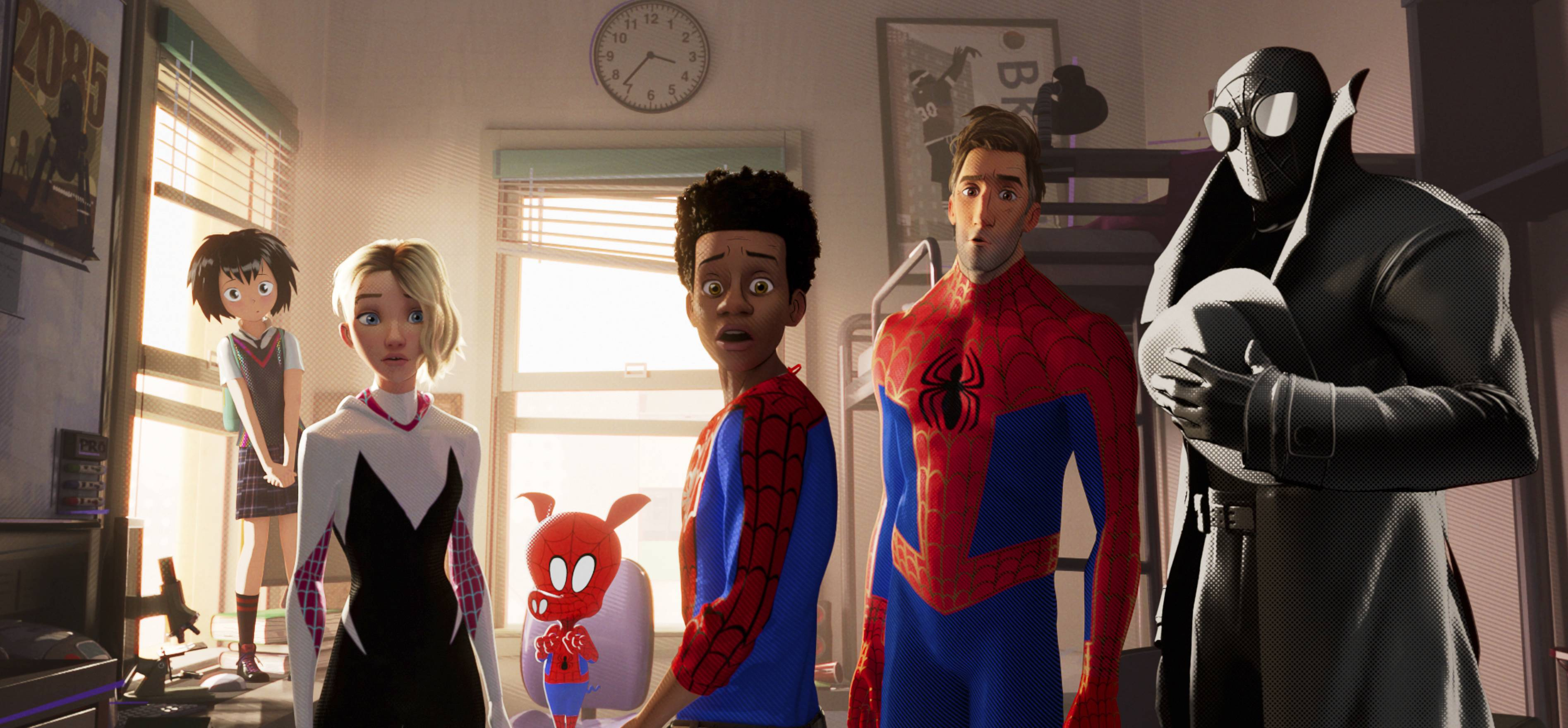 "Miles Morales (voiced by Shameik Moore), center, teams up with Peni (Kimiko Glen), left, Spider-Gwen (Hailee Steinfeld), Spider-Ham (John Mulaney), Peter Parker (Jake Johnson) and Spider-Man Noir (Nicolas Cage) in ""Spider-Man: Into the Spider-Verse."