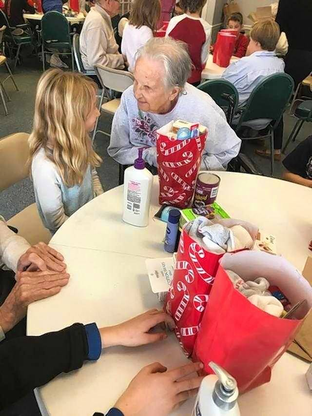 "Fourth grade-students from Williamsburg Elementary School and residents of Arden Courts memory care center in Geneva got together to create ""Blessing Bags"" for the Lazarus House shelter in St. Charles."