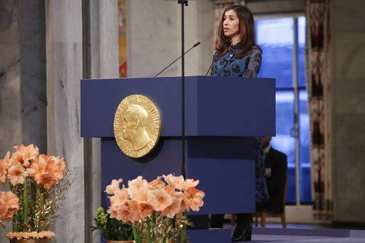 The Peace Prize laureate Nadia Murad from Iraq, gives a speech during the Nobel Peace Prize Ceremony in Oslo Town Hall, Oslo, Monday Dec. 10, 2018. Dr. Denis Mukwege of Congo and Nadia Murad of Iraq jointly receive the Nobel Peace Prize recognising their efforts to end the use of sexual violence as a weapon of war and armed conflict. (Haakon Mosvold Larsen / NTB scanpix via AP, Pool)