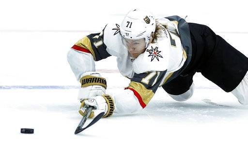 FILE - In this Nov. 1, 2018, file photo, Vegas Golden Knights' William Karlsson, of Sweden, reaches for a loose puck during the first period of an NHL hockey game against the St. Louis Blues, in St. Louis. Hindsight is 43/35 for the Columbus Blue Jackets. That's how many goals and assists William Karlsson put up for the Vegas Golden Knights after the Blue Jackets let him go in the expansion draft. (AP Photo/Jeff Roberson, File)