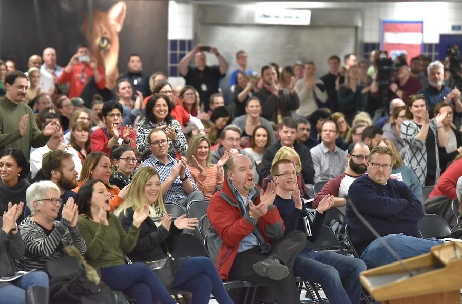 Parents, students and teachers pack the Conant High School cafeteria Thursday evening during Palatine-Schaumburg High School District 211's last regularly scheduled board meeting of 2018 to make and listen to public comment about the possibility of a teachers strike during final exams next week.