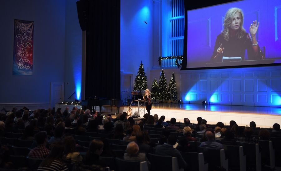 """We are here to gather our courage,"" Beth Moore said at the Wheaton College GC2 summit Thursday. ""We are here to face that some of our systems have created susceptibility and unanswered culpability."""