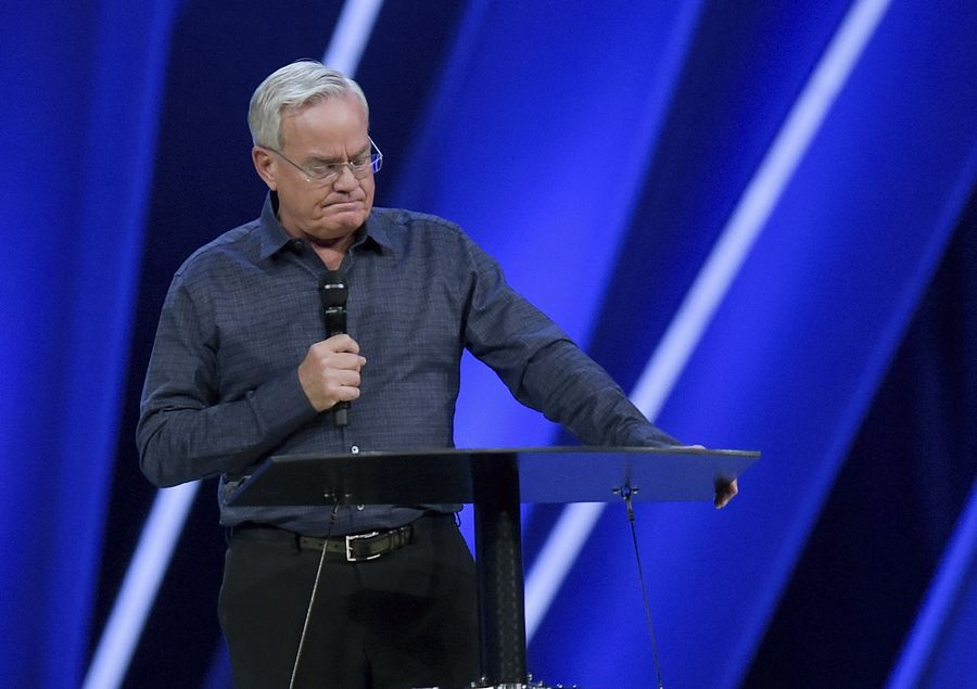 Willow Creek Community Church Senior Pastor Bill Hybels stands before his congregation to announce his early retirement amid a cloud of misconduct allegations involving women in his congregation. The announcement was made during a special meeting at the church, which he founded and is one of the nation's largest evangelical congregations.