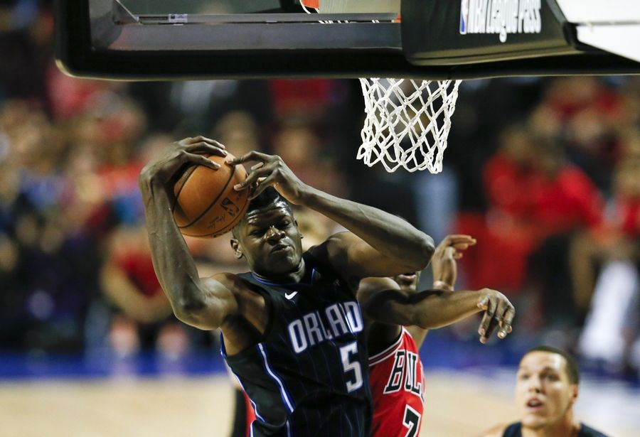 0eceb3c5f701 Orlando Magic s Mo Bamba snags a rebound against Chicago Bulls  Justin  Holiday in the first