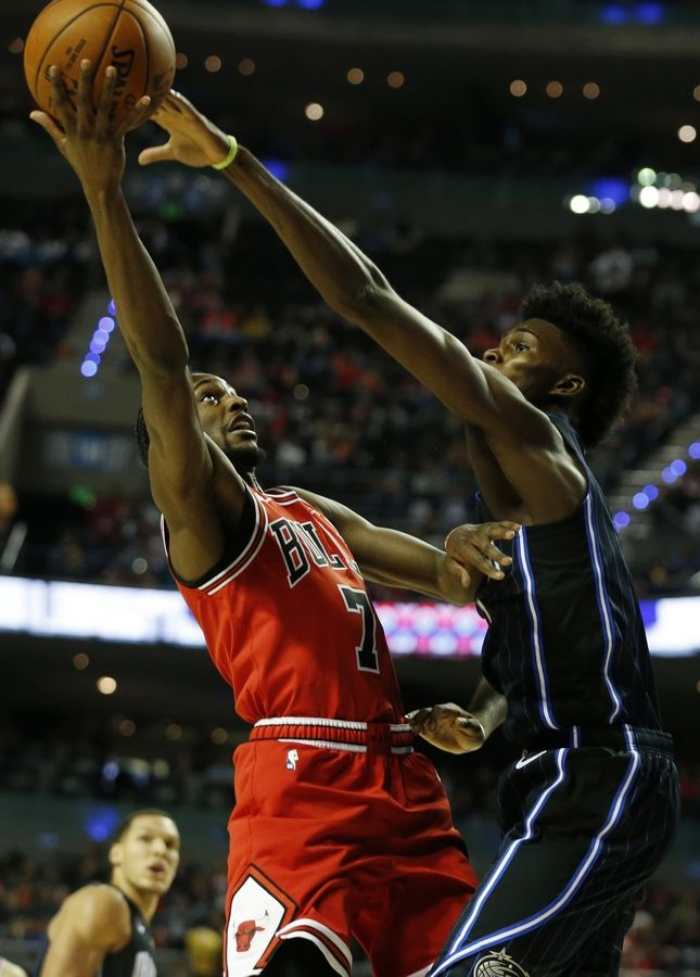 ae05e55314c5 Chicago Bulls  Justin Holiday tries to move the ball past Orlando Magic s  Jonathan Isaac during