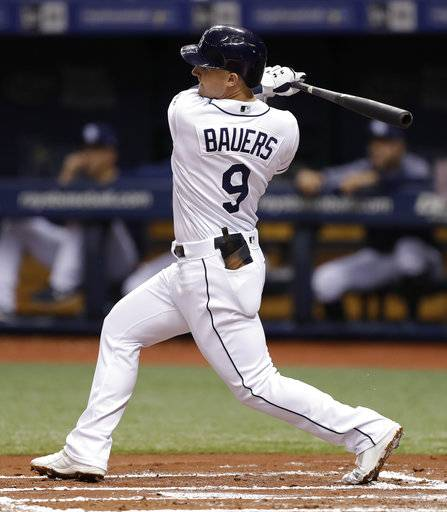 FILE - In this Aug. 8, 2018, file photo, Tampa Bay Rays' Jake Bauers bats during the first inning of a baseball game against the Baltimore Orioles, in St. Petersburg, Fla. Edwin Encarnacion has been traded to Seattle and first baseman Carlos Santana has returned to the Indians in a three-team deal that also involved Tampa Bay. The Rays got infielder Yandy Diaz and minor league right-hander Cole Slusser from Cleveland. The Indians also acquired first baseman Jake Bauers. The swap came Thursday, Dec. 13, 2018,  at the close of the winter meetings.