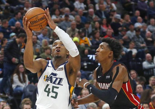 7a975f10f088 Utah Jazz guard Donovan Mitchell (45) goes to the basket as Miami Heat guard