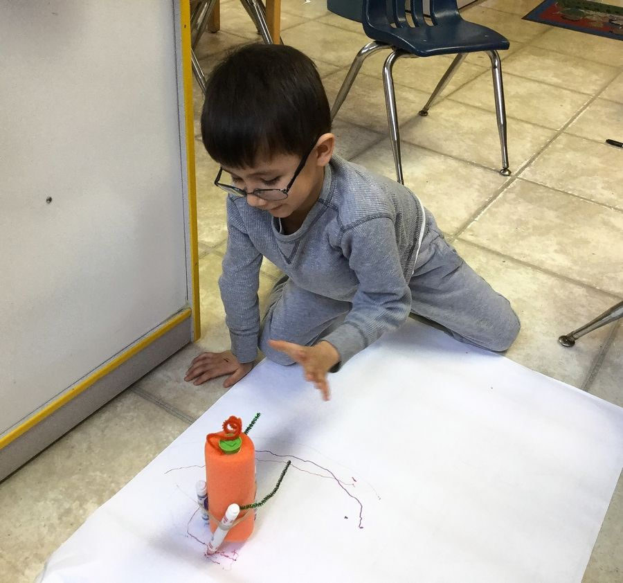 Riley Podgorny, a kindergarten-enrichment student at St. Mark Preschool and Enrichment Center, learns about motors and design as he tests out his self-propelled drawing machine.