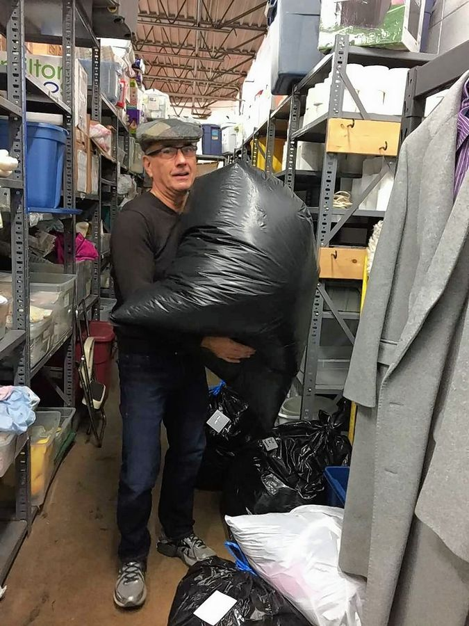 STEP 1: Bill Denwood of Naperville collects clothing donations from Sharing Connections in Downers Grove for the nonprofit organization he founded called Suits for Success, which gathers professional clothing from the Western suburbs and donates it to prisoners before they leave custody of the Illinois Department of Corrections.
