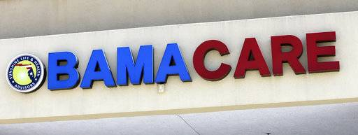 "File- This May 11, 2017, file photo shows an Obamacare sign being displayed on the storefront of an insurance agency in Hialeah, Fla. A conservative federal judge in Texas on Friday, Dec. 14, 2018, ruled the Affordable Care Act ""invalid� on the eve of the sign-up deadline for next year. But with appeals certain, even the Trump White House said the law will remain in place for now. In a 55-page opinion, U.S. District Judge Reed O'Connor ruled Friday that last year's tax cut bill knocked the constitutional foundation from under ""Obamacare� by eliminating a penalty for not having coverage. The rest of the law cannot be separated from that provision and is therefore invalid, he wrote."