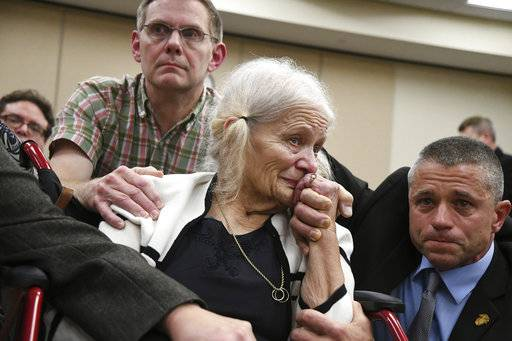 Nick Williams, left, brother of Mike Williams, the man who was shot and killed by his best friend 18 years ago, Cheryl Williams, center, mother of Mike Williams, along side family friend Geosie Visnovski, cry tears of joy for a the guilty verdicts in the trial against Denise Williams, Mike's former wife, Friday, Dec. 14, 2018. (Alicia Devine/Tallahassee Democrat via AP, Pool)