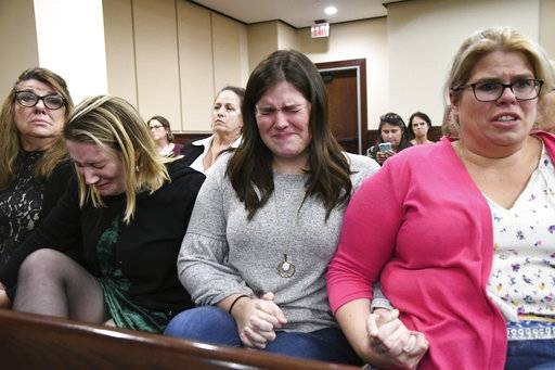 A flood of emotions pours out into the courtroom as the verdicts are read in the trial against Denise Williams for the murder of her husband Mike Williams, the man who was shot and killed by his high school best friend, Friday, Dec; 14, 2018. (Alicia Devine/Tallahassee Democrat via AP, Pool)