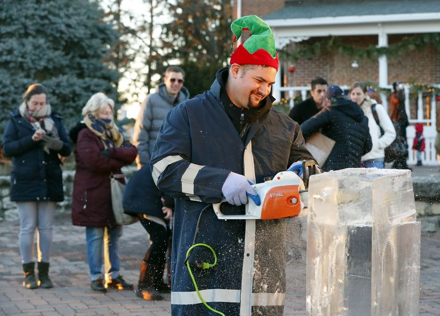 Max Barajas of Nadeau's Ice Sculptures begins his carving Saturday during Christmas on the Farm at Peck Farm Park in Geneva. People got to spend the evening enjoying some of the pleasures of Christmas past.