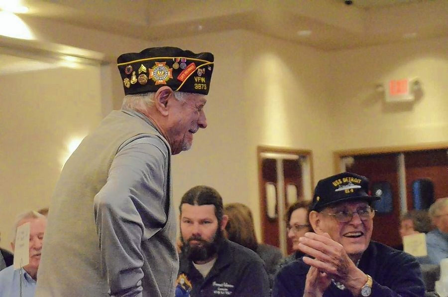 Naperville residents George Hogrewe, left, and Joe Marinello were among World War II veterans recognized at the annual Pearl Harbor Day luncheon Dec. 10 at Gaslite Manor Banquets in Aurora. Hogrewe served in the Navy; Marinello served in the Army Air Corps.
