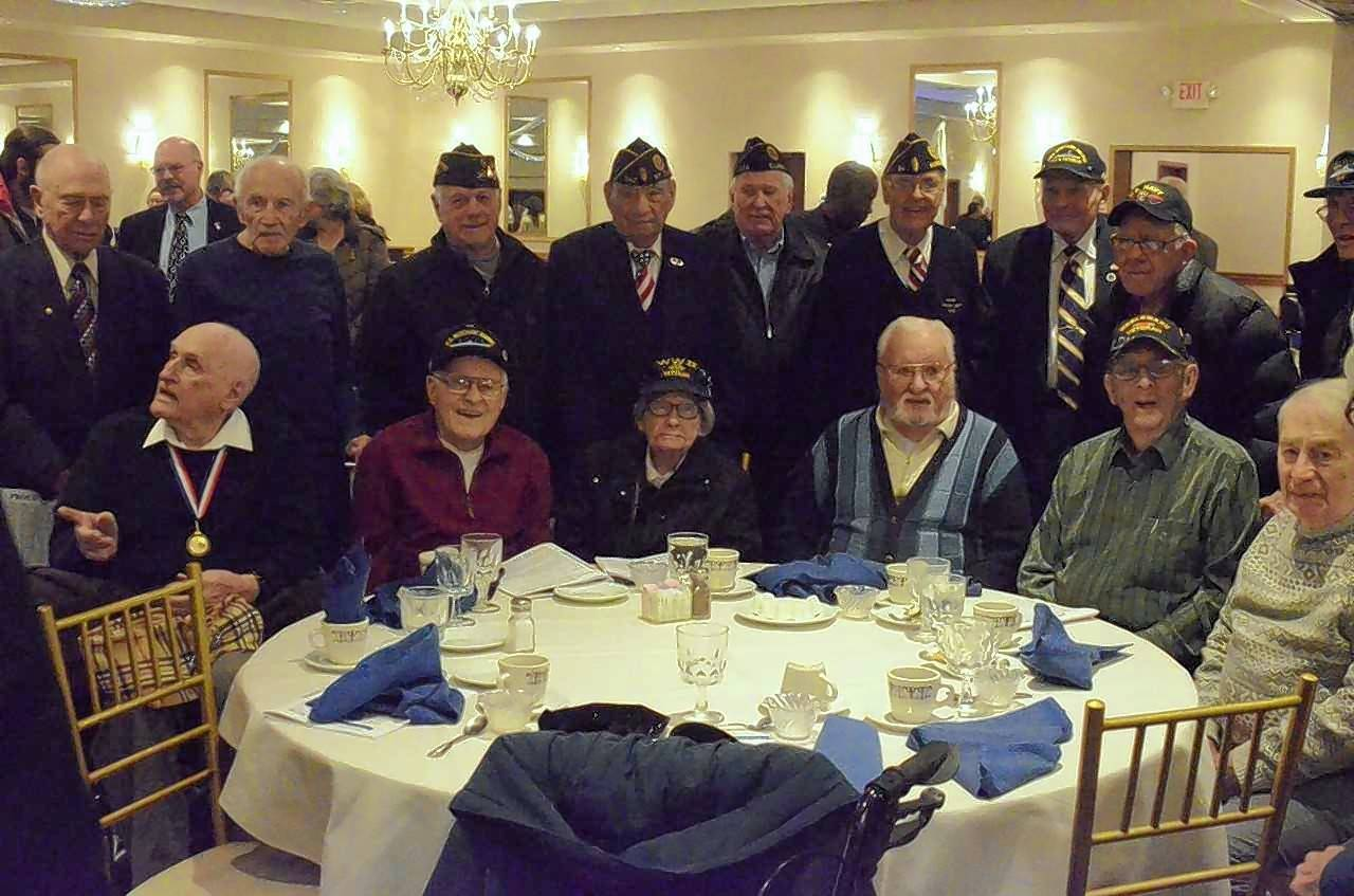 Elgin resident and Pearl Harbor attack survivor Everett Schlegel, seated left, joined World War II veterans for a photo after the annual Pearl Harbor Day memorial luncheon Monday at Gaslite Manor Banquets in Aurora. The event, sponsored by Naperville Rotary Club and Aurora Navy League Council, saluted veterans and 12 area youth for community service.