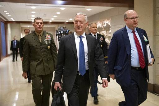 Secretary of Defense Jim Mattis arrives to give House members a classified security briefing, with Secretary of State Mike Pompeo, not shown, on the murder of Jamal Khashoggi and Saudi Arabia's war in Yemen, on Capitol Hill in Washington, Thursday, Dec. 13, 2018. (AP Photo/J. Scott Applewhite)