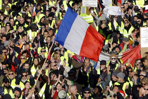 "People wearing their yellow vests demonstrate Saturday, Dec. 15, 2018 in Marseille, southern France. The ""yellow vest"" movement, which takes its name from the fluorescent safety vests French motorists must all have in their vehicles, emerged in mid-November as a protest against fuel tax increases. (AP Photo/Claude Paris)"