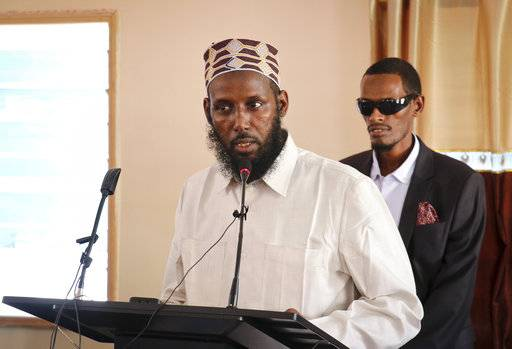 FILE - In this Wednesday, Oct. 10, 2018 file photo, Mukhtar Robow, who was once deputy leader of Africa's deadliest Islamic extremist group the al-Qaida-linked al-Shabab, speaks at a press conference about his candidacy for a regional presidency, in Baidoa, Somalia. A Somali official says Ethiopian troops that are part of the African Union forces supporting the Somali government have arrested Robow in Baidoa. (AP Photo/File)