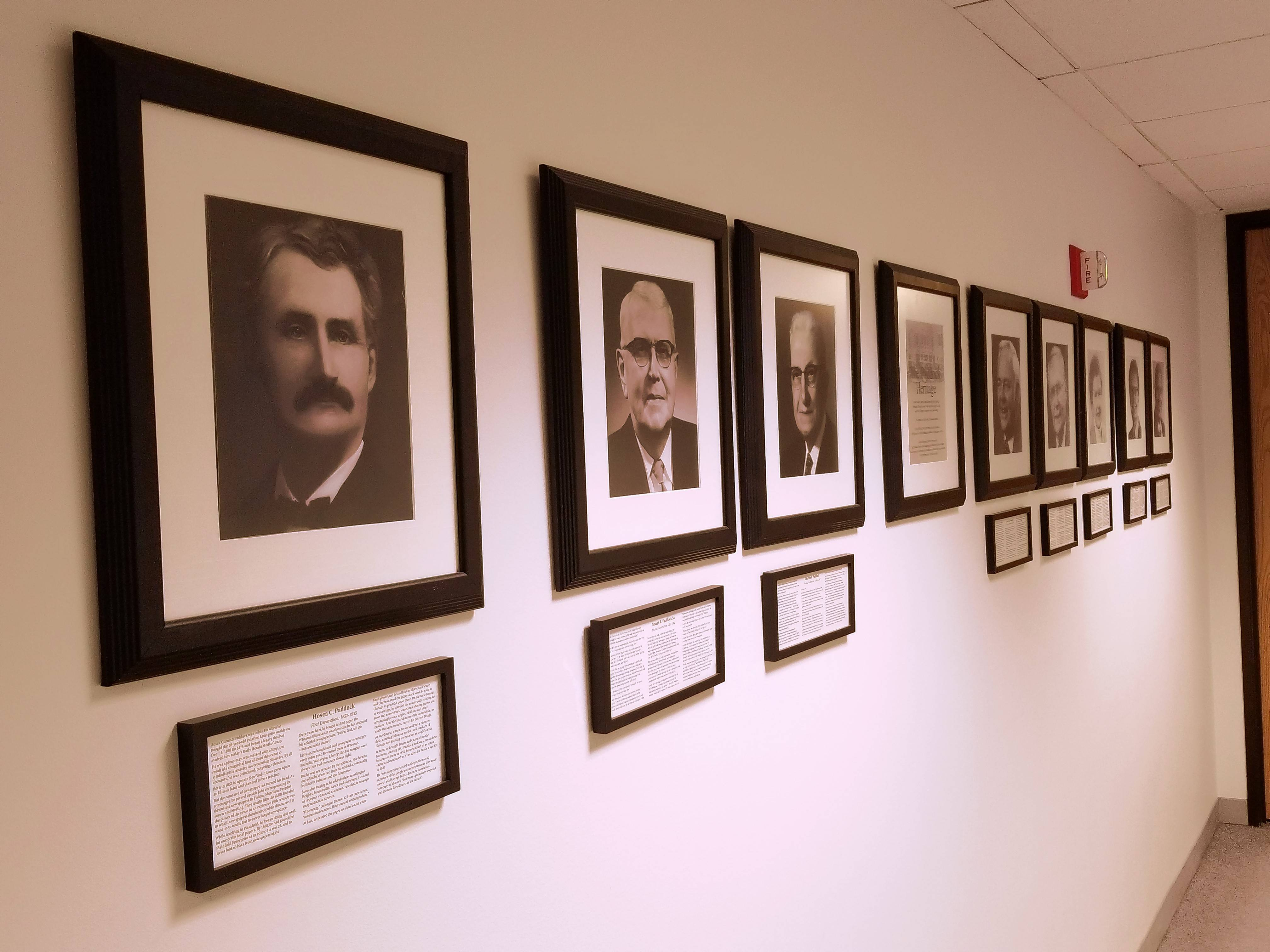 Photos of the four generations of Paddock family members who led the Daily Herald for the past 120 years hang on a wall leading into the newsroom.