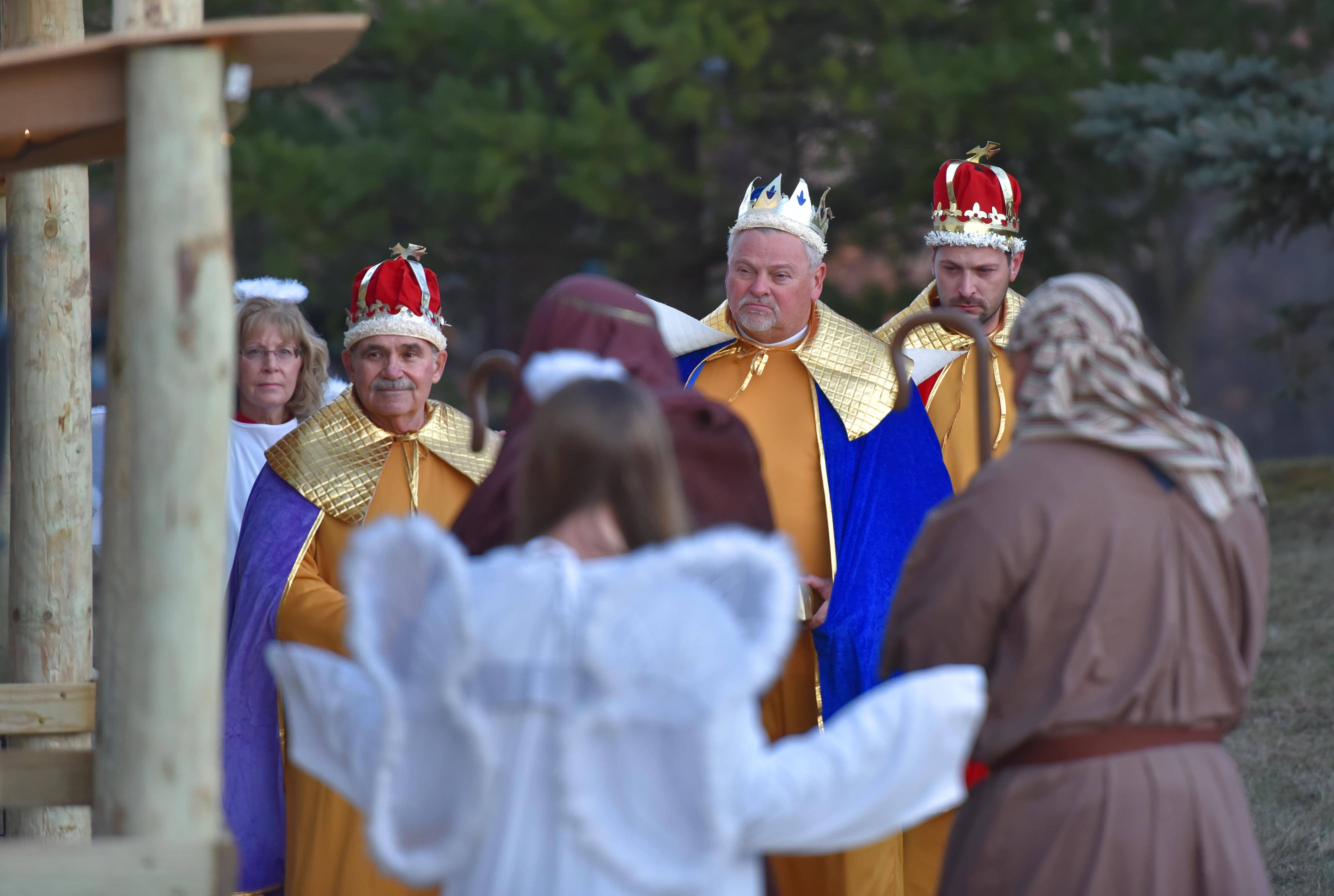 The three Magi, played by congregation members Wayne Schambach and Ken and Jeff Volkening, approach the place where Jesus was born during a live Nativity performance Sunday, at St. Paul's United Church of Christ in Elgin.