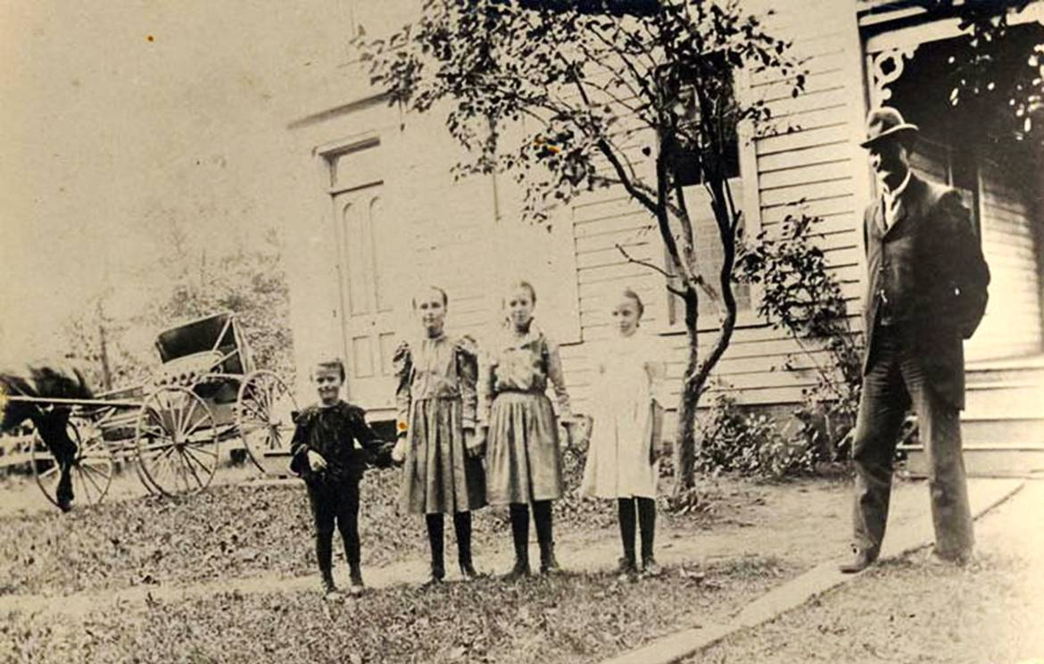 This photo from about 1900 of Hosea C. Paddock with four of his six children -- from left, David, Lucile, Daisy and Jeanette -- was taken shortly after he bought the Palatine Enterprise, which grew into the Daily Herald. His two oldest sons Stuart and Charles, not shown, became second-generation leaders of the newspaper company.