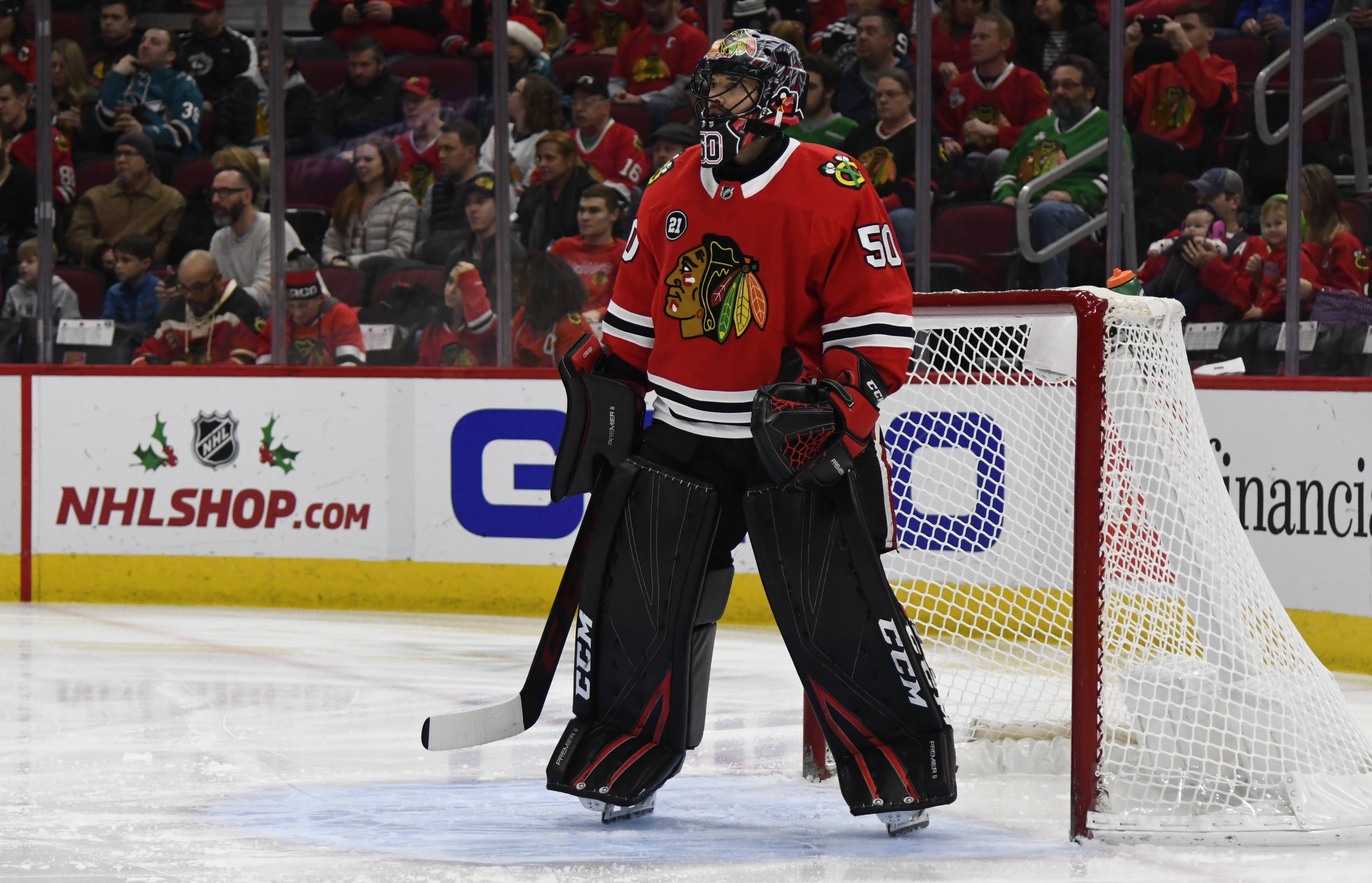 Chicago Blackhawks goaltender Corey Crawford looks on during the first period against the San Jose Sharks Sunday at the United Centero. Crawford left the game with 1:30 left in the first period after the back of his head struck the right post during a goalmouth pile-up.