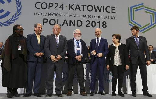 Heads of the delegations react at the end of the final session of the COP24 summit on climate change in Katowice, Poland, Saturday, Dec. 15, 2018.