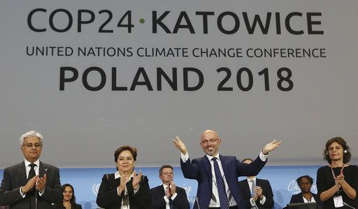 Michal Kurtyka, a senior Polish official chairing the negotiations, poses for a photo after adopting the final agreement during a closing session of the COP24 U.N. Climate Change Conference 2018 in Katowice, Poland, Saturday, Dec. 15, 2018.