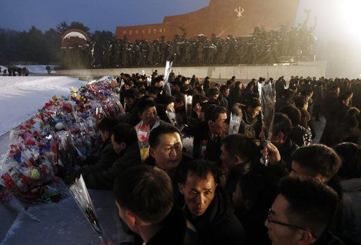 North Koreans lay flowers at the base of the bronze statues of their late leaders Kim Il Sung and Kim Jong Il at Mansu Hill Grand Monument in Pyongyang, North Korea, Sunday, Dec. 16, 2018.  Many North Koreans are marking the seventh anniversary of the death of leader Kim Jong Il with visits to the statues and vows of loyalty to his son, Kim Jong Un.