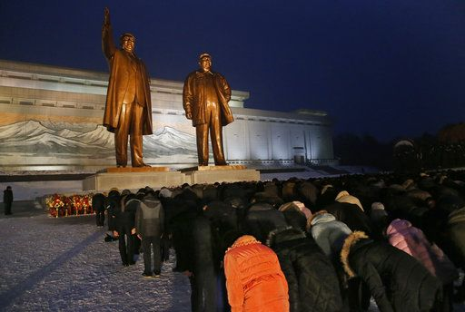 North Koreans bow at the bronze statues of their late leaders Kim Il Sung and Kim Jong Il at Mansu Hill Grand Monument in Pyongyang, North Korea, Sunday, Dec. 16, 2018.  Many North Koreans are marking the seventh anniversary of the death of leader Kim Jong Il with visits to the statues and vows of loyalty to his son, Kim Jong Un.