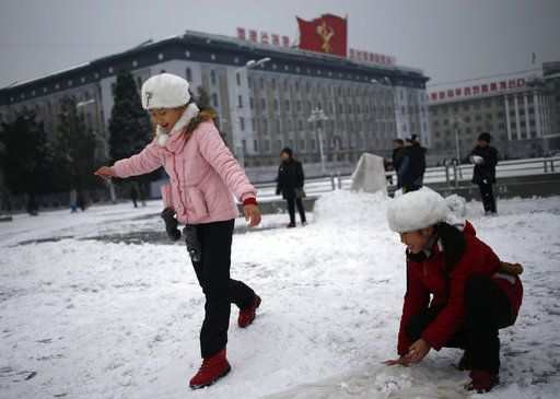 North Korean girls play with the snow on Kim Il Sung Square in Pyongyang, North Korea, where the winter season has started, on Sunday, Dec. 16, 2018.