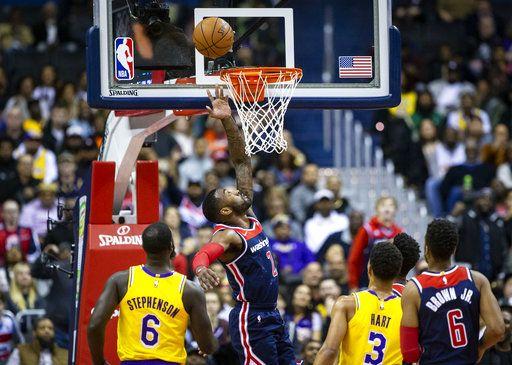 e198423cd42a Washington Wizards guard John Wall (2) goes for a layup past Los Angeles  Lakers