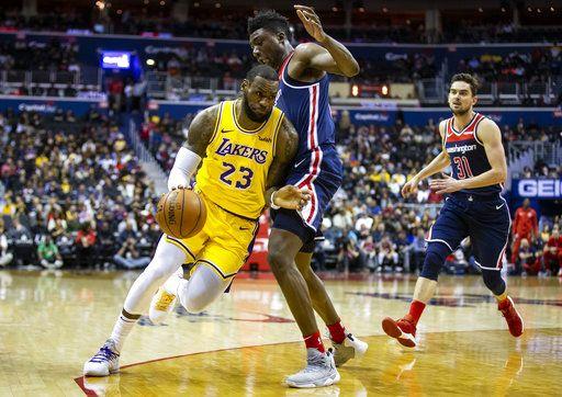 ede876c465f6 Los Angeles Lakers forward LeBron James (23) dribbles past Washington  Wizards center Thomas Bryant