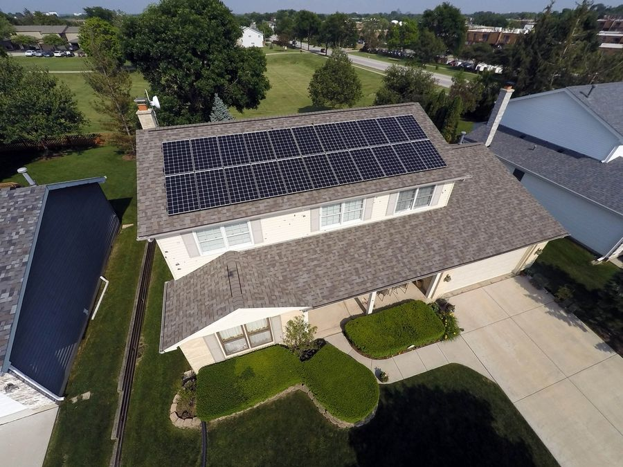 Towns and counties that earn SolSmart designation aim to have user-friendly solar permit processes for residents and business owners. Ryan Ziolko of Schaumburg installed solar panels on his house in April.