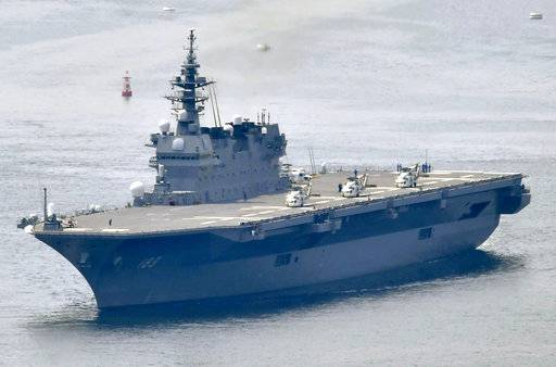 Japan to spend more on defense, refit 1st aircraft carrier