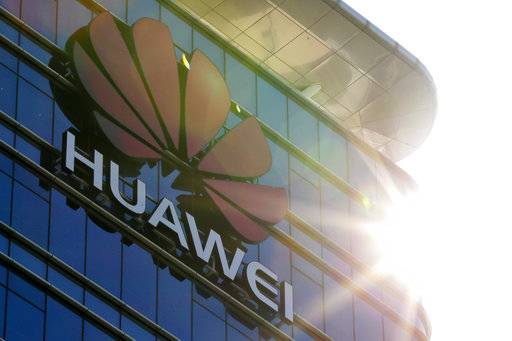 The logo of Huawei stands on its office building at the research and development centre in Dongguan in south China's Guangdong province, Tuesday, Dec. 18, 2018. While a top executive of Chinese tech giant Huawei faces possible U.S. charges over trade with Iran, the company's goal to be a leader in next-generation telecoms is colliding with security worries abroad. Australia and New Zealand have barred Huawei as a supplier for fifth-generation networks, joining the U.S. and Taiwan. Last week, Japan's cybersecurity agency said Huawei and other vendors deemed risky will be off-limits for government purchases. (AP Photo/Andy Wong)