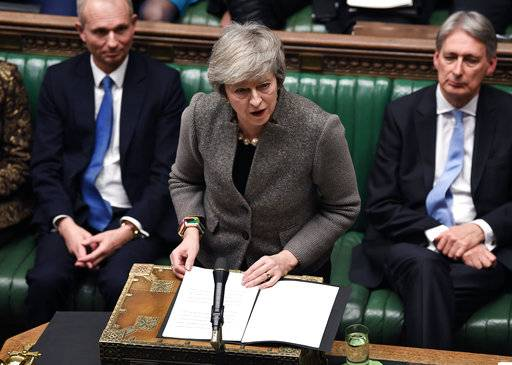 In this photo provided by the UK Parliament, Britain's Prime Minister Theresa May delivers a speech in the House of Commons in London, Monday, Dec. 17, 2018. Prime Minister Theresa May said Monday that the postponed vote in Parliament on Britain's Brexit agreement with the European Union will be held the week of Jan. 14 - more than a month after it was originally scheduled and just 10 weeks before Britain leaves the EU. (Jessica Taylor/UK Parliament via AP)