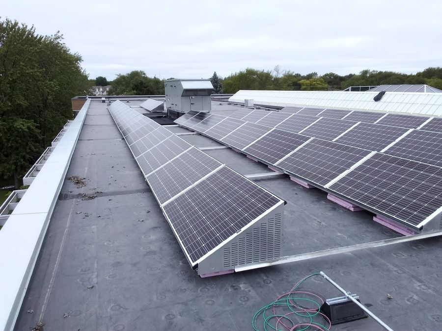 Sixty solar panels, installed in September on the library's roof, became active in December.