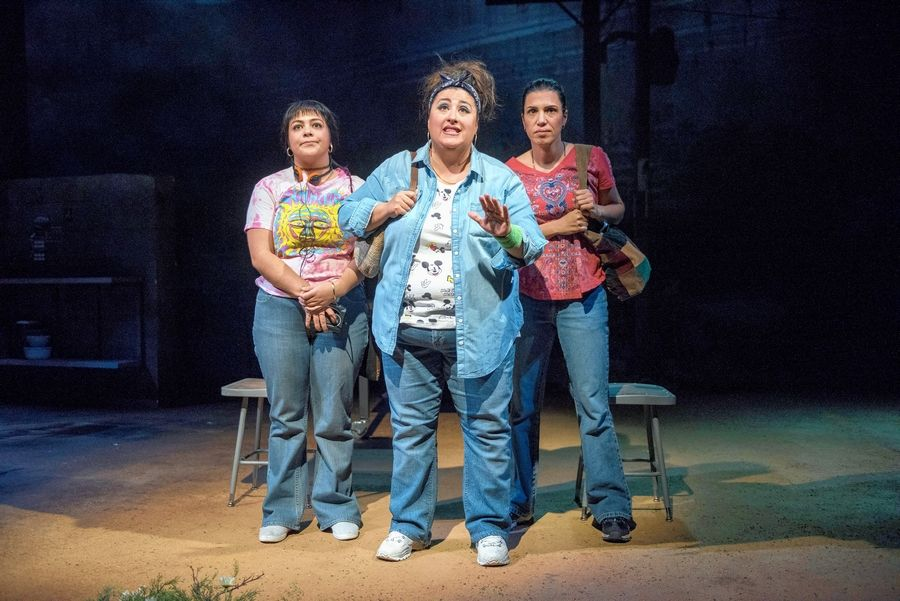 "Fearing for their safety, Zaide (Mari Marroquin), center, and her fellow workers at an American-owned factory in Juarez, Mexico, ask a bus driver to drop them closer to their homes in Steppenwolf Theatre's ""La Ruta."""
