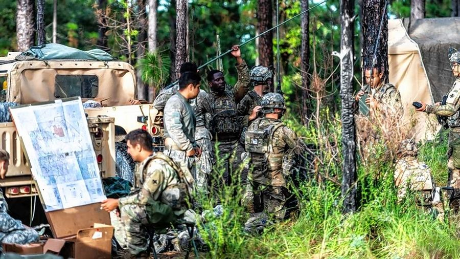 Soldiers from Headquarters Company, 178th Infantry Battalion, confer with forward observers during training exercises held at the Joint Readiness Training Center at Fort Polk, Louisiana. The battalion has been notified of its summer 2019 deployment to Afghanistan.