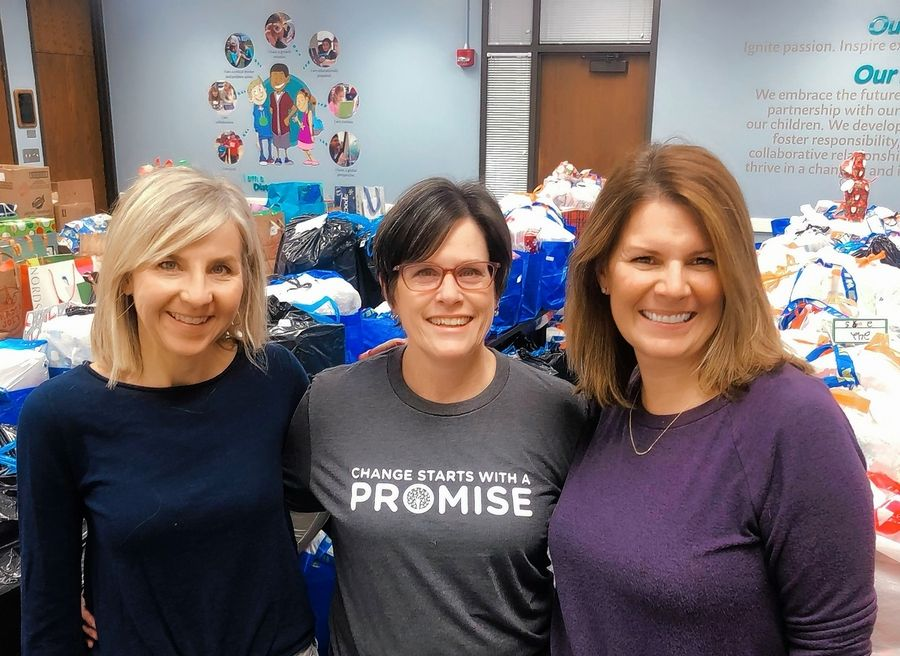 With the support of community partners, Therese Crawford, Glen Ellyn Elementary District 41 school board member Erica Nelson and Karen Winter organized a Holiday Sharing program to provide gifts for 595 children and grocery store gift cards for families in need.