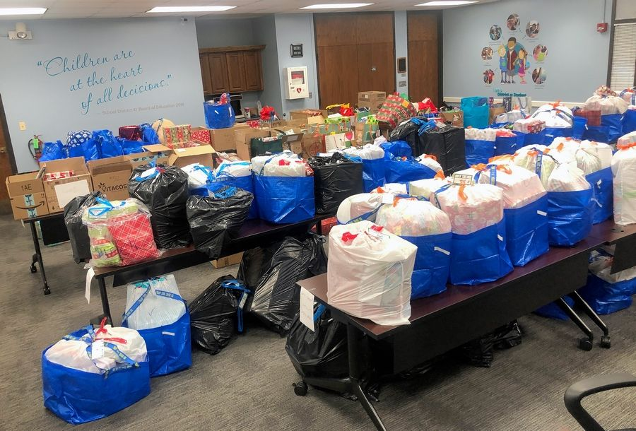 Volunteers delivered donated gifts from the school board room in the Glen Ellyn Elementary District 41 Central Services Office.