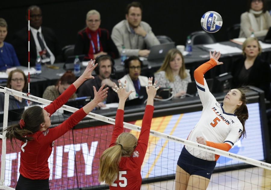 Illinois' Ali Bastiannelli (5) hits against Nebraska's Mikaela Foecke (2) and Callie Schwarzenbach (25) in the first set of a semifinal match of the NCAA Div I Women's Volleyball Championships Thursday, Dec. 13, 2018, in Minneapolis.