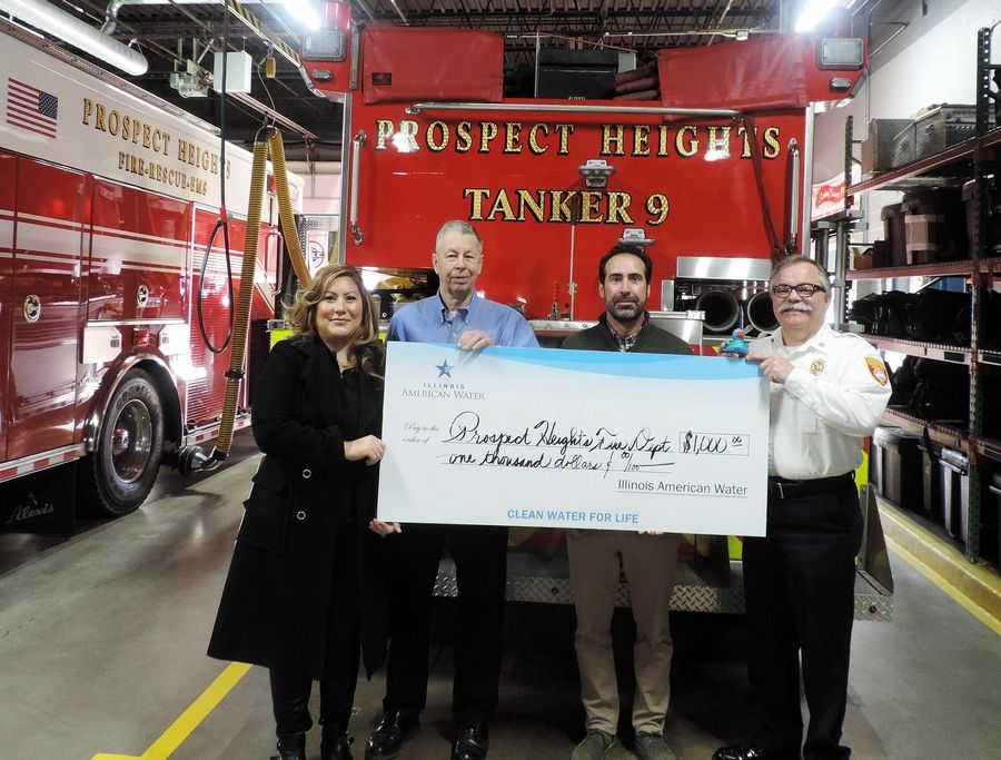 (Left to Right) Natalee Cedillo, Municipal Advocate, Illinois American Water; Jon Tammen, Board President; Tom Harrell, Operations Supervisor, Illinois American Water; and Fire Chief Drew Smith. Photo provided by Illinois American Water